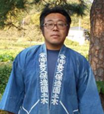 富田 健二 (創業者 従弟)